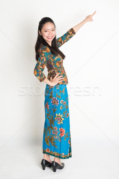 Asian woman pointing Stock photo © szefei