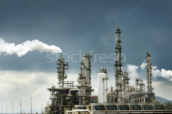 Oil refinery with smoke Stock photo © szefei