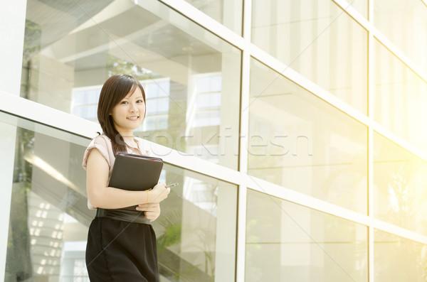 Young Asian woman executive smiling Stock photo © szefei