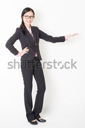 Asian businesswoman presenting something Stock photo © szefei