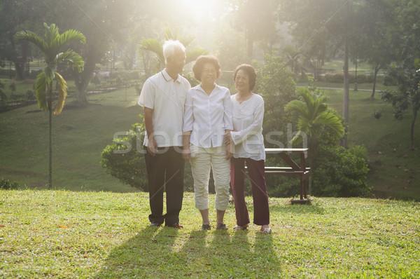 Group of Asian seniors walking at outdoor Stock photo © szefei