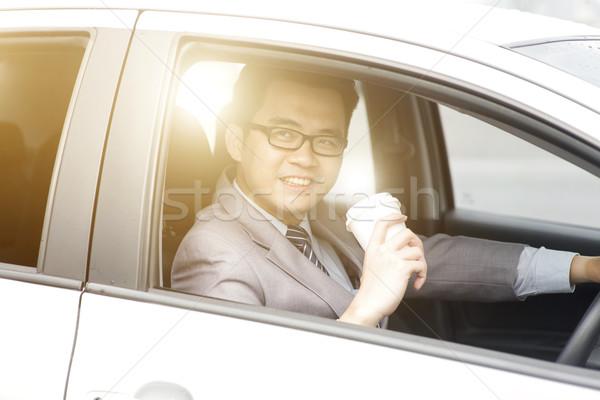 Having coffee while driving Stock photo © szefei