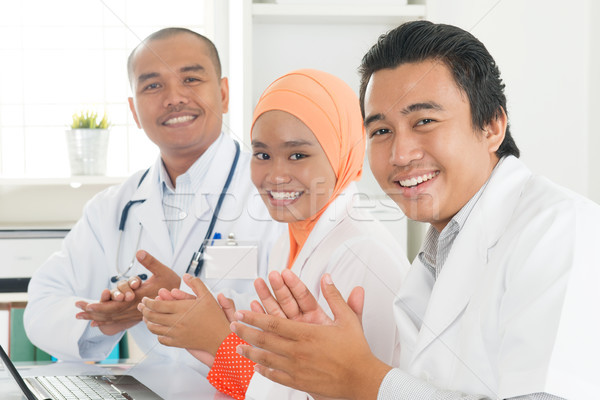 Doctors clapping hands Stock photo © szefei