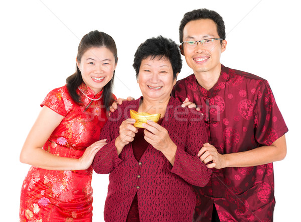 Asian Chinese family greeting Stock photo © szefei