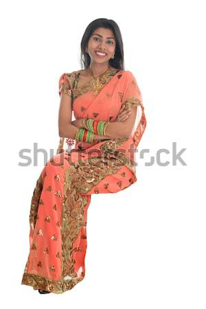 Indian woman seated on a transparent chair. Stock photo © szefei