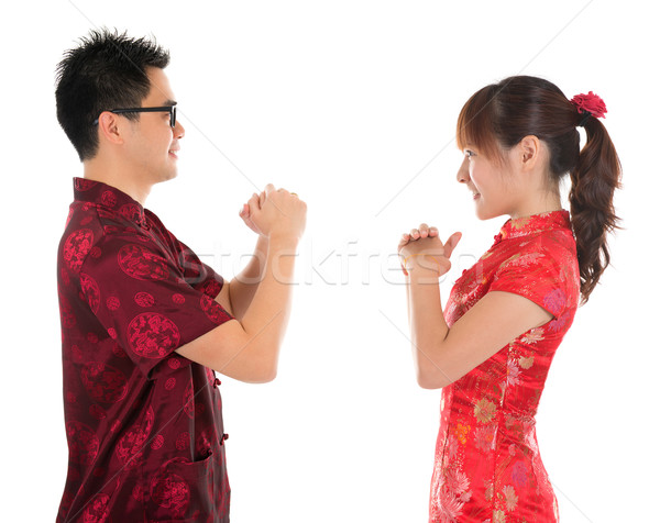 Chinese cheongsam people respecting to each other Stock photo © szefei