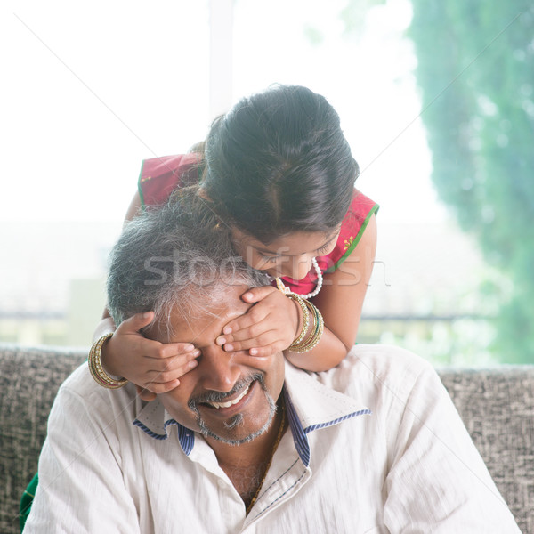 Girl surprising her father by covering daddy eyes Stock photo © szefei