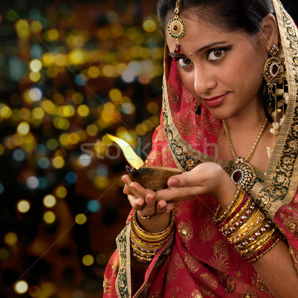 Indian woman hands holding diwali oil lamp Stock photo © szefei