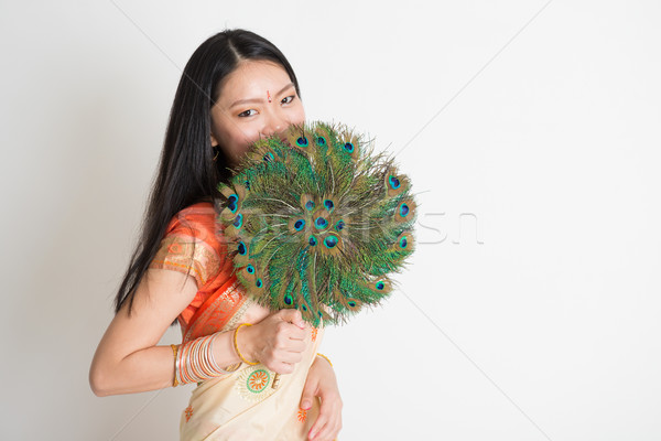 Female with peacock feather fan in Indian sari dress Stock photo © szefei