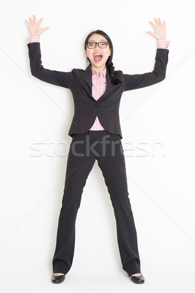 Shocked Asian businesswoman bang and leaning wall Stock photo © szefei