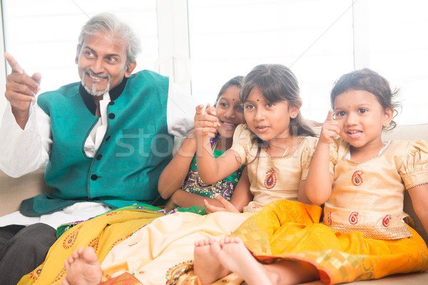 Father and daughters watching tv Stock photo © szefei