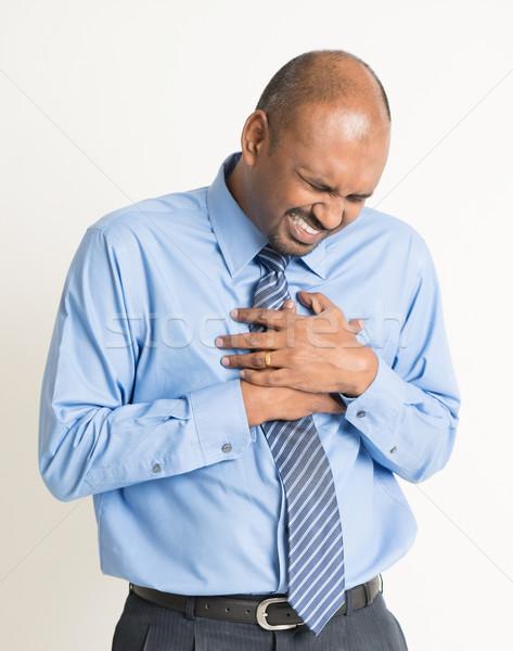 Indiai üzletember szívfájdalom kisajtolás mellkas fájdalmas Stock fotó © szefei