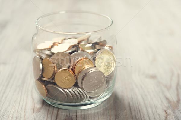 Coins in glass money jar Stock photo © szefei