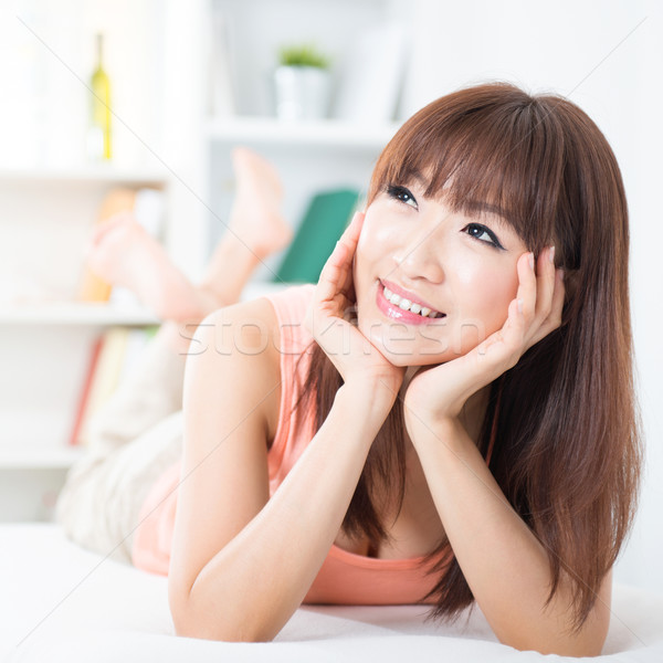Asian girl daydreaming Stock photo © szefei