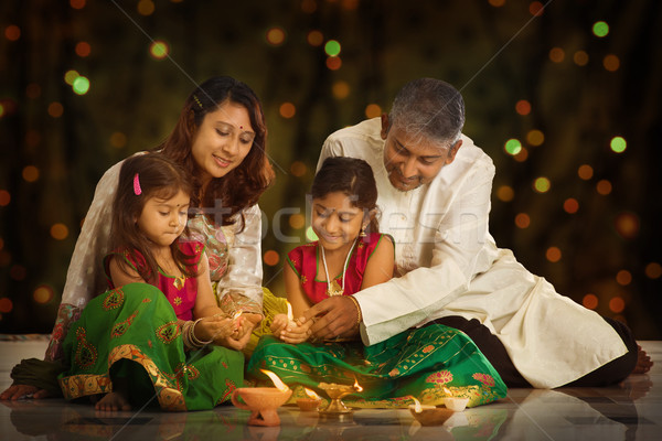 Indian family celebrating Diwali, fesitval of lights Stock photo © szefei