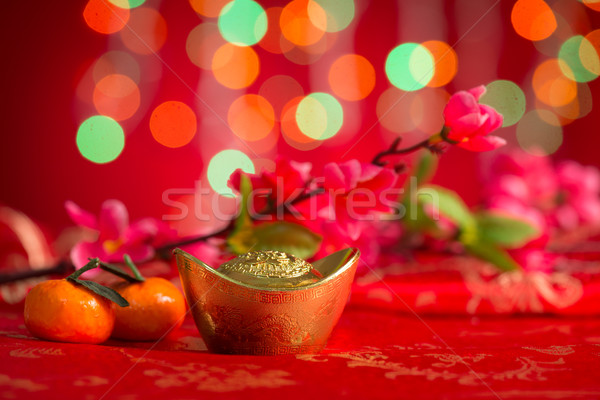 Chinese New Year decorations gold ingots on red background Stock photo © szefei
