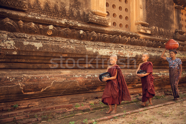 Buddhist novice monks walking alms in Bagan Stock photo © szefei