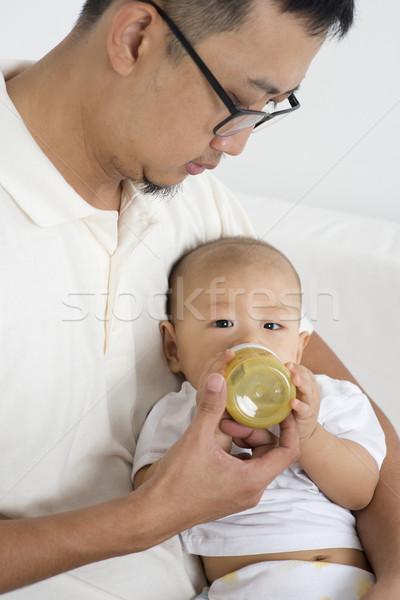 Father bottle feed baby Stock photo © szefei