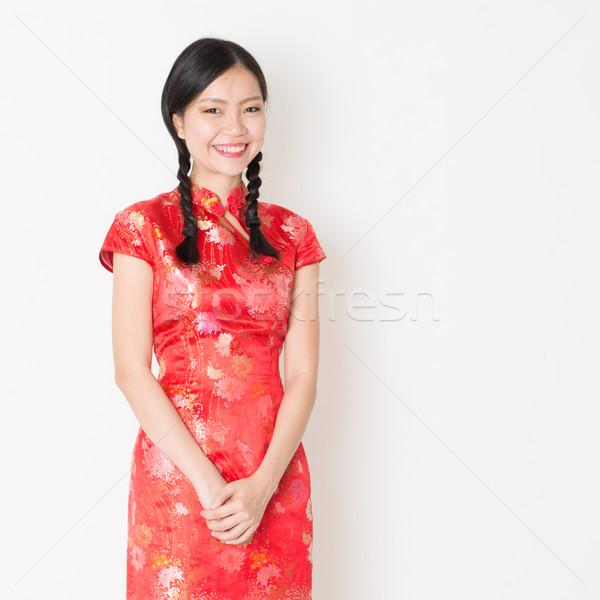 Oriental girl in red qipao Stock photo © szefei