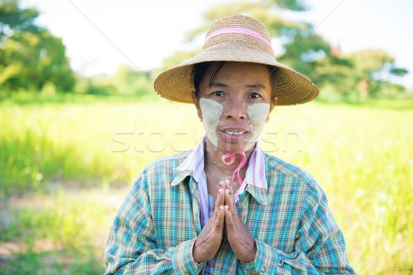 Traditional mature Asian female farmer greeting Stock photo © szefei