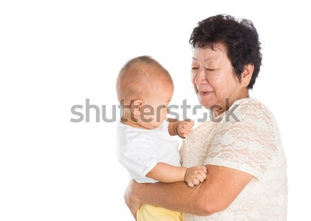 Grandmother taking care grandchild Stock photo © szefei