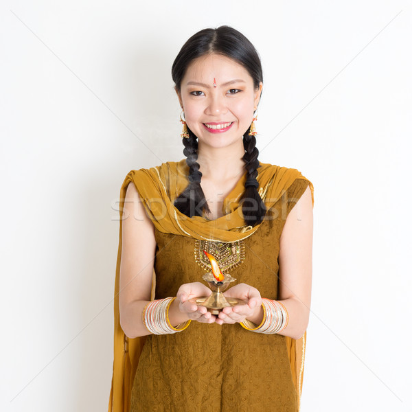 Woman holding Diwali light Stock photo © szefei