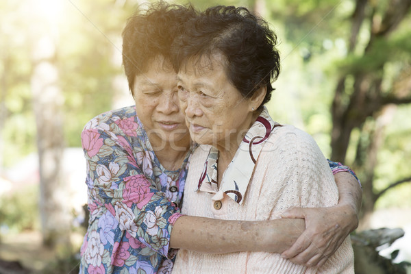 Asian elderly women hugging Stock photo © szefei