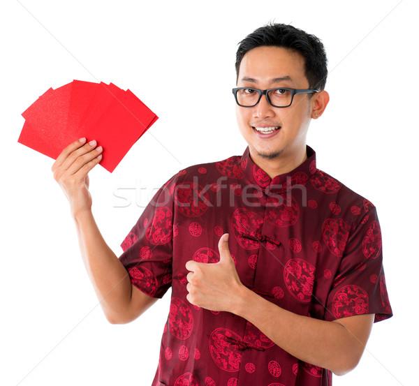 Hüvelykujj felfelé ázsiai kínai férfi mutat Stock fotó © szefei