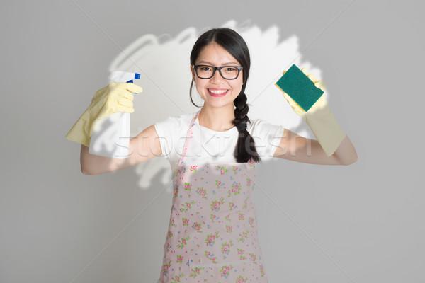 Woman doing house chores. Stock photo © szefei