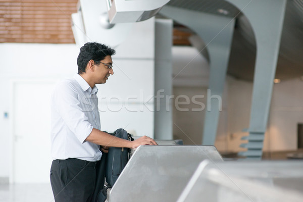 Stock photo: Indian man at airport check in counter
