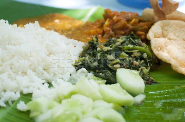 Indian cuisine banana leaf Stock photo © szefei