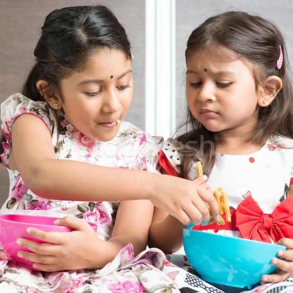 Stock photo: Sibling sharing foods