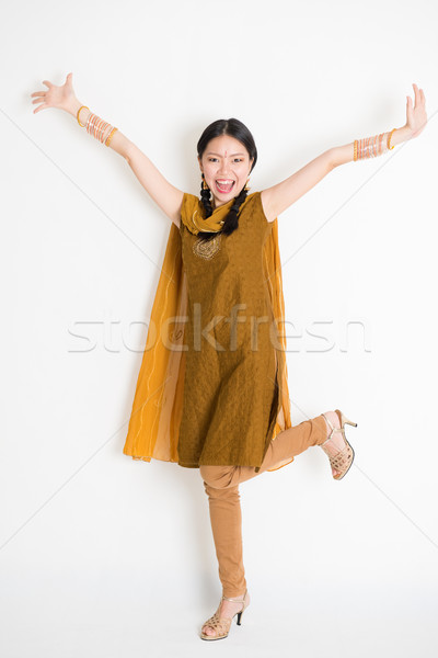 Excited Indian Chinese female arms raised Stock photo © szefei