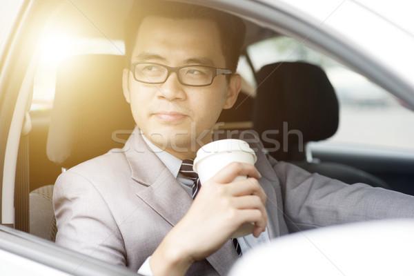 Man drinking coffee while driving Stock photo © szefei
