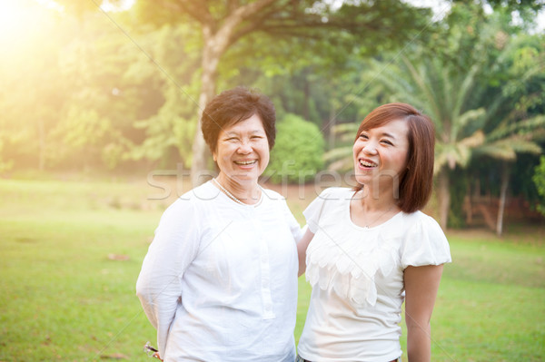 Elderly mother and grown daughter Stock photo © szefei