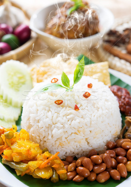 Nasi lemak with fresh hot steam Stock photo © szefei