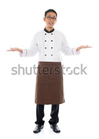 Happy Asian chef welcoming pose Stock photo © szefei