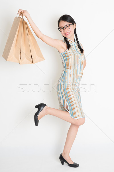 Asian Chinese girl hands holding paper shopping bags Stock photo © szefei