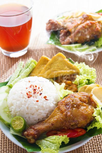 Indonesian food nasi ayam penyet Stock photo © szefei