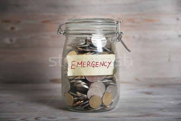 Money jar with emergency label. Stock photo © szefei
