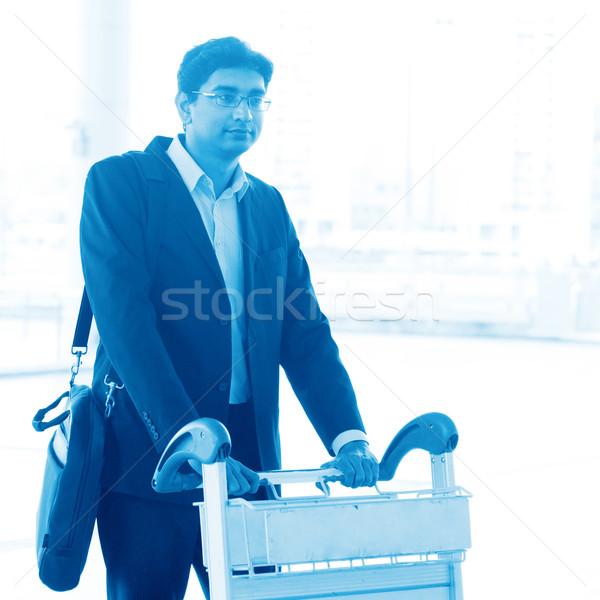 Man walking with airport trolley Stock photo © szefei