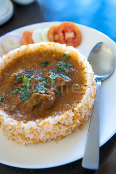 Culinária indiana frango arroz comida tabela prato Foto stock © szefei