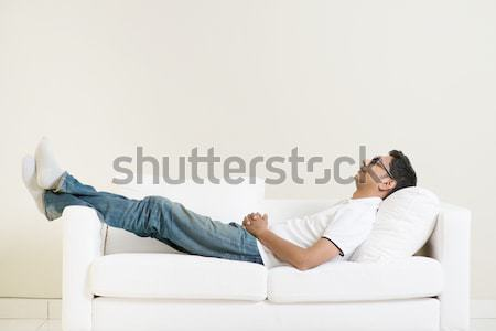 Indian guy daydreaming Stock photo © szefei
