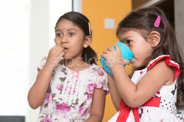 Stock photo: Children eating and drinking