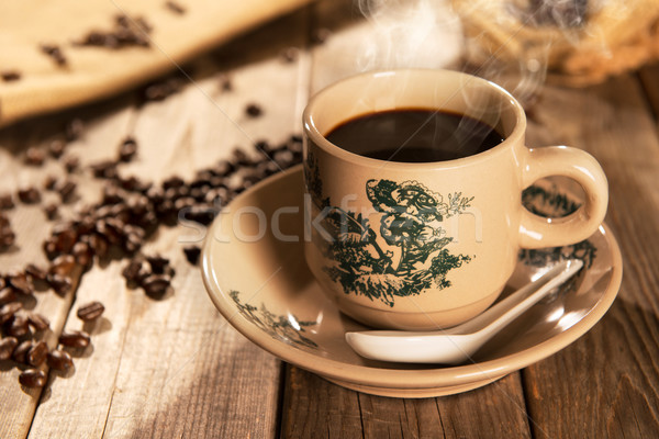 Traditional style Hainanese coffee in vintage mug Stock photo © szefei