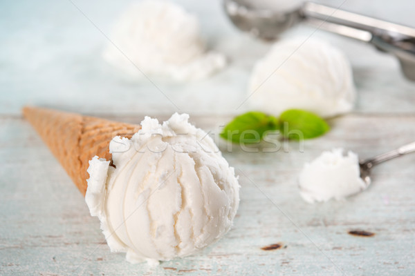 Closeup vanilla milk ice cream cone Stock photo © szefei