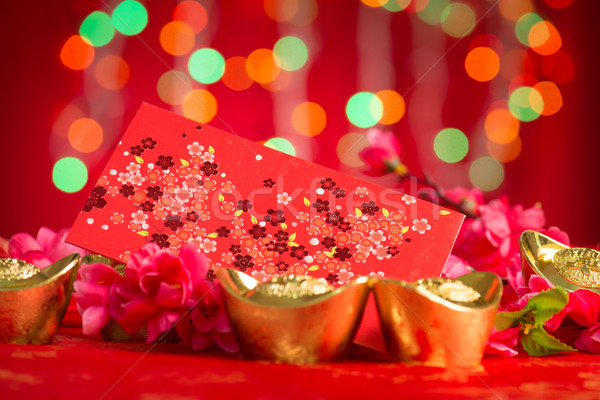 Chinese New Year decorations red packet and gold ingots Stock photo © szefei