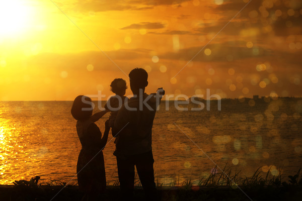 Silhouette of family in outdoor sunset Stock photo © szefei