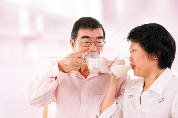 Asian mature couple drinking soy milk  Stock photo © szefei