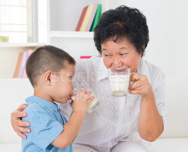 Family drinking milk Stock photo © szefei